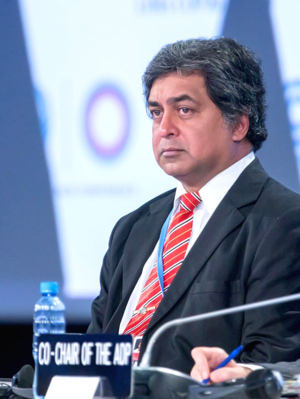 Kishan Kumarsingh, co-chair of the Ad Hoc Working Group on the Durban Platform for Enhanced Action (ADP), attends the opening plenary session of the ADP in Lima, capital of Peru, Dec. 2, 2014. .