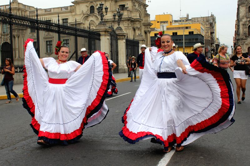 """Costa Rican dancers perform during the """"Parade of the World Cultures"""" in the framework of the 8th International Meeting of Folklore """"My Peru ..."""