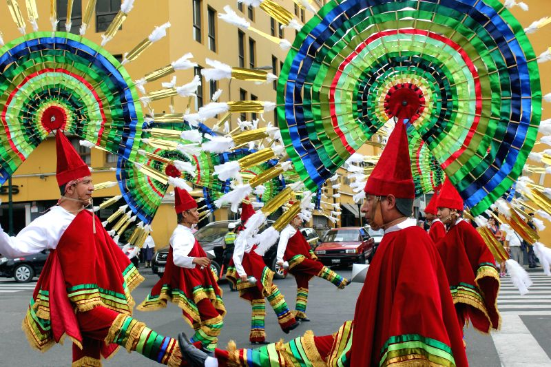 """Mexican dancers perform during the """"Parade of the World Cultures"""" in the framework of the 8th International Meeting of Folklore """"My Peru 2015"""", in ..."""