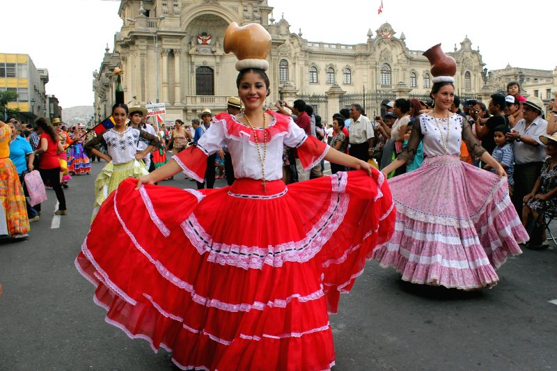 """Paraguayan dancers perform during the """"Parade of the World Cultures"""" in the framework of the 8th International Meeting of Folklore """"My Peru 2015"""", ..."""