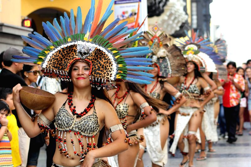"""Peruvian dancers perform during the """"Parade of the World Cultures"""" in the framework of the 8th International Meeting of Folklore """"My Peru 2015"""", ..."""