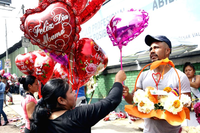 LIMA, May 15, 2017 - A man buys a balloon on Mother's Day in Lima, Peru, on May 14, 2017.
