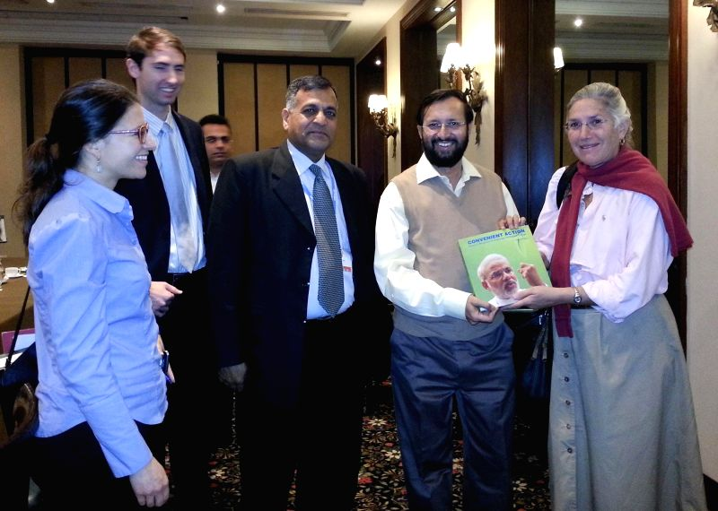 Lima (Peru): Minister of State for Environment, Forest and Climate Change (Independent Charge), Prakash Javadekar presents to the United States delegation the Prime Minister, Narendra Modi`s book on . - Narendra Modi