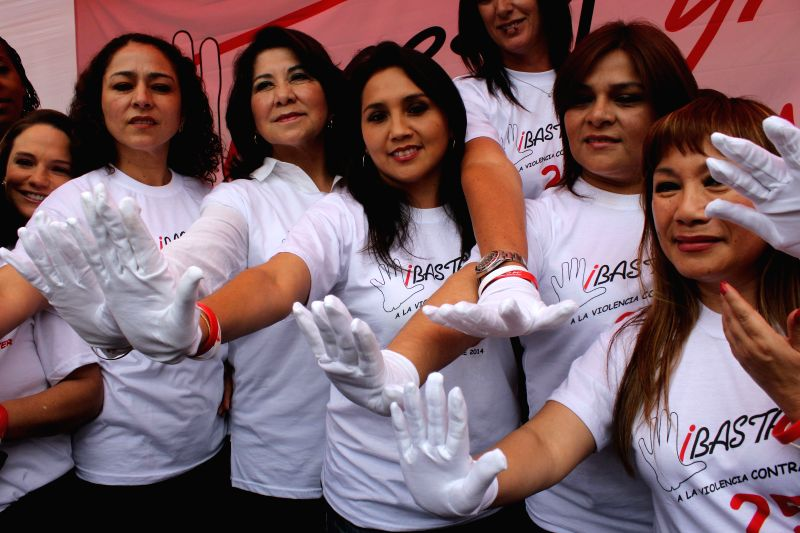 Lima (Peru): People take part in a rally to mark the International Day of the Elimination of Violence Against Women in Lima, capital of Peru, Nov. 25, 2014. United Nations figures showed that 35 ...