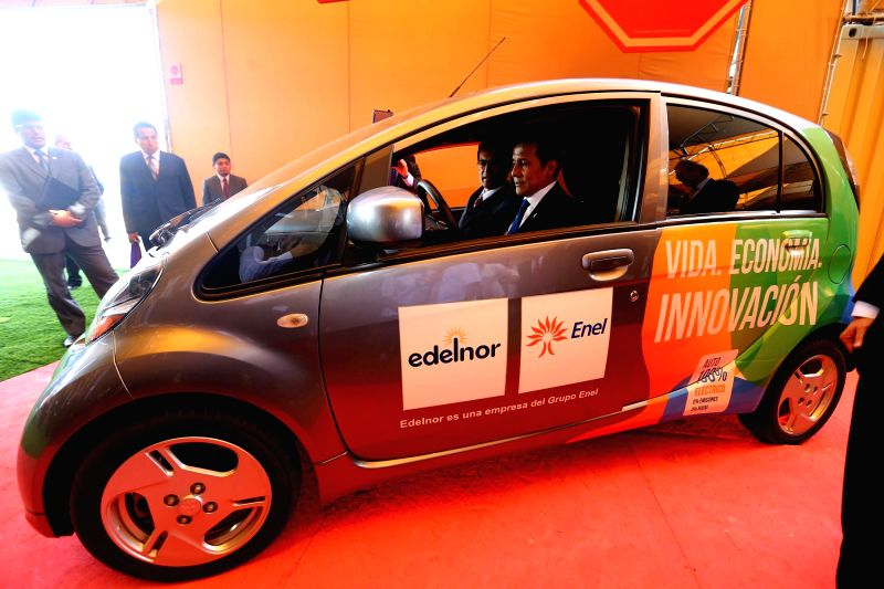 "Peru's President, Ollanta Humala (front) tries a vehicle during the opening of exposition ""Voices for Climate"" under the framework of the UN 20th session of the Conference of the ..."