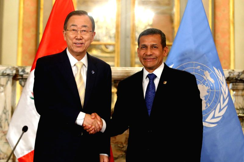 President of Peru, Ollanta Humala (R), and Secretary-General of the United Nations (UN), Ban Ki-moon (L), take part in the issue of a joint statement, in Lima, Peru, on Dec. 12, 2014. ...