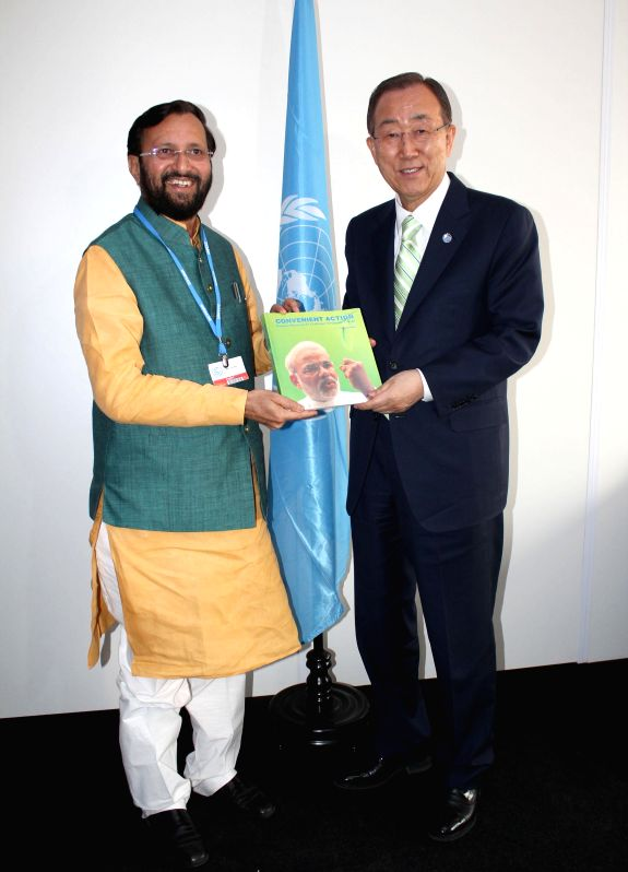The Union Minister of State for Environment, Forest and Climate Change (Independent Charge) Prakash Javadekar presents the book on Climate Change authored by the Prime Minister Narendra Modi, .. - Narendra Modi