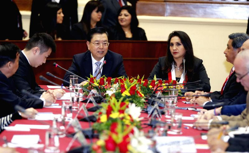 Zhang Dejiang (center L), chairman of the Standing Committee of China's National People's Congress (NPC), holds talks with President of the Peruvian Congress Ana Maria Solorzano (center R) in ..