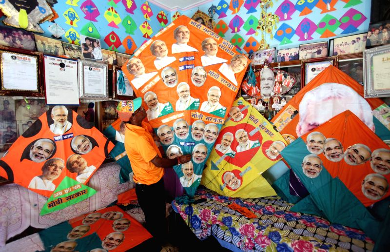 Limca Book record holder and famous Kite maker Jagmohan Kanojia shows his kites with BJP Prime Ministerial candidate and Gujarat Chief Minister Narendra Modi's picture in Amritsar on May 16, 2014. - Narendra Modi