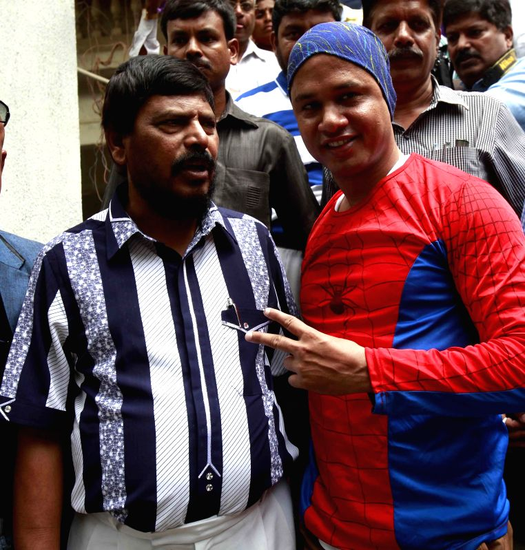 Limca Book record holder Gaurav Sharma (popularly known as spider-man) who scaled 45-story Shreepati Arcade building at Nana Chowk in South Mumbai within 19 minutes earlier this year being welcomed .. - Gaurav Sharma