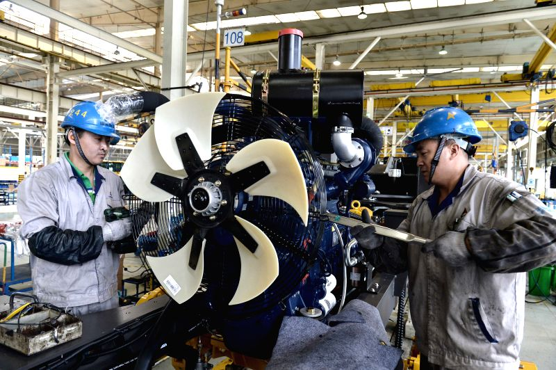 LINYI, May 5, 2017 - Workers are seen on the assembly line of loading machine in Shandong Lingong Construction Machinery Co., Ltd. in Linyi, east China's Shandong Province, May 4, 2017. The ...