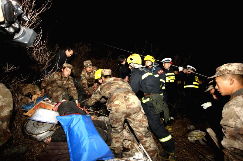 Rescuers work at the site of a road accident which claimed 20 lives in Linzhou City, central China's Henan Province, March 3, 2015. Twenty people have been ...