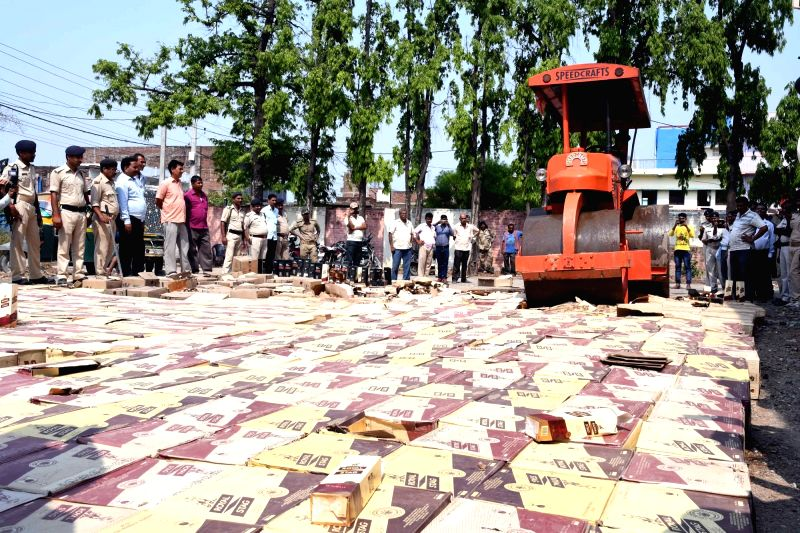 Liquor bottles being destroyed in Patna on May 29, 2017.