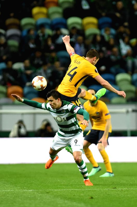 LISBON, April 13, 2018 - Marcos Acuna (Down) of Sporting vies with Gabi of Atletico during the Europa League quarterfinal second leg soccer match between Sporting CP and Club Atletico de Madrid at ...