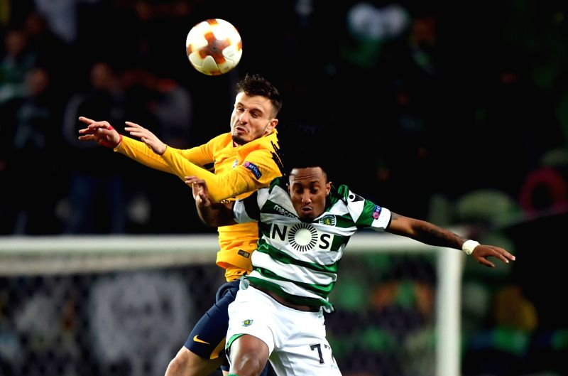 LISBON, April 13, 2018 - Saul Niguez (L) of Atletico vies with Gelson Martins of Sporting during the Europa League quarterfinal second leg soccer match between Sporting CP and Club Atletico de Madrid ...