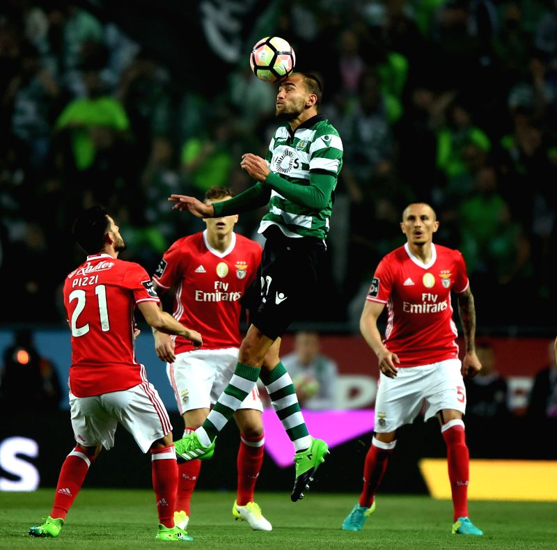 LISBON, April 23, 2017 - Sporting's Bas Dost (Top) vies for a header during Portuguese league soccer match between Sporting CP and SL Benfica at Alvalade Stadium in Lisbon, Portugal, April 22, 2017. ...
