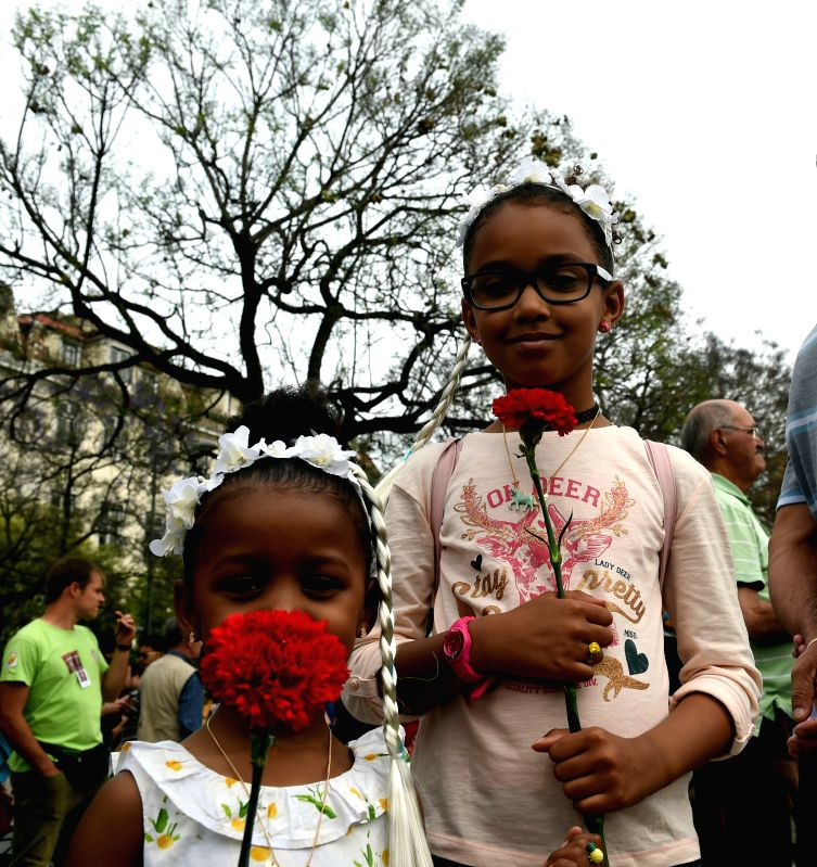 LISBON, April 26, 2017 - Portuguese children take part in a demonstration marking the Carnation Revolution's 43rd anniversary in Lisbon, Portugal, April 25, 2017. (Xinhua/Zhang Liyun)