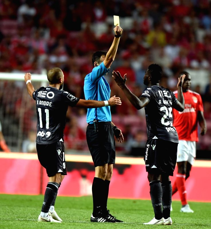LISBON, Aug. 11, 2018 - Alhassan Wakaso (R) of Guimaraes gets a yellow card for foul during the Portuguese league football match between SL Benfica and Vitoria Guimaraes SC at the Luz Stadium in ...