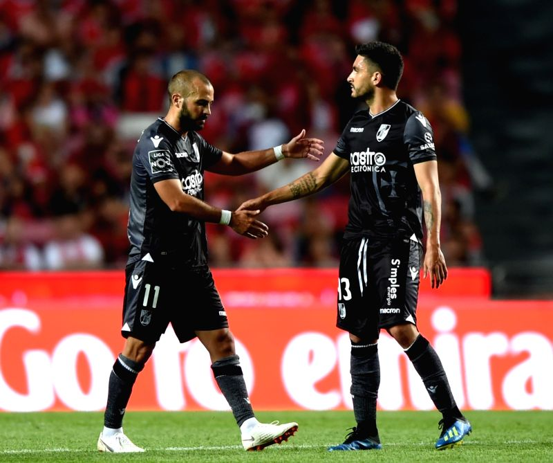 LISBON, Aug. 11, 2018 - Andre Andre (L) of Guimaraes celebrates with teammateg Guillermo Celis after scoring a goal during the Portuguese league football match between SL Benfica and Vitoria ...