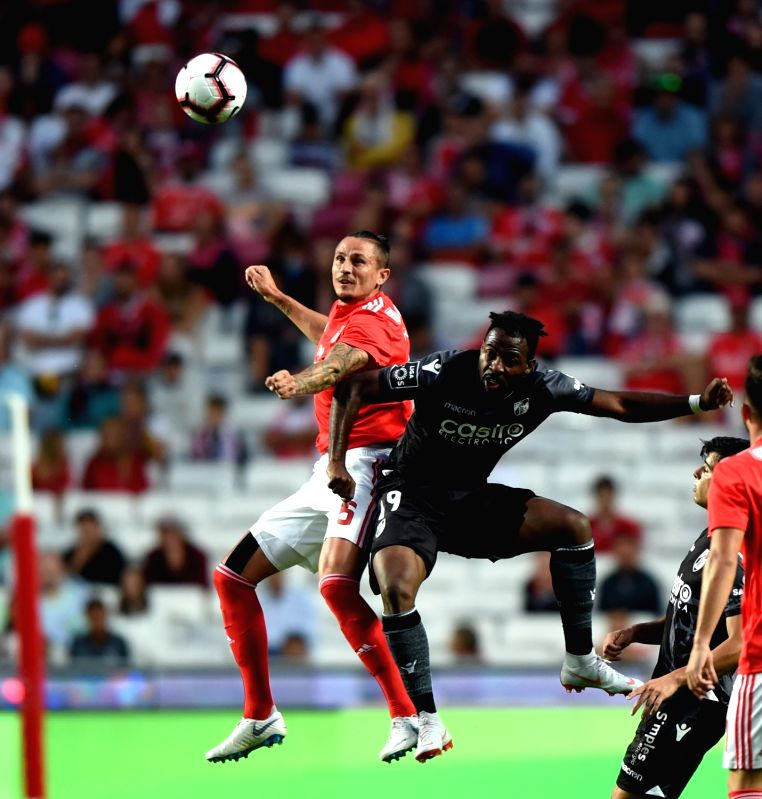 LISBON, Aug. 11, 2018 - Ljubomir Fejsa (L) of Benfica vies with Junior Tallo of Guimaraes during the Portuguese league football match between SL Benfica and Vitoria Guimaraes SC at the Luz Stadium in ...