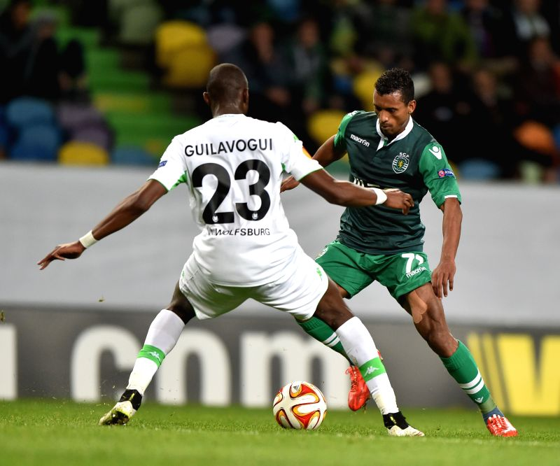 Sporting's Nani (R) vies for the ball Wolfsburg's Josuha Guilavogui during the UEFA Europa League round of 32 second leg match between Sporting Clube de Portugal and ...