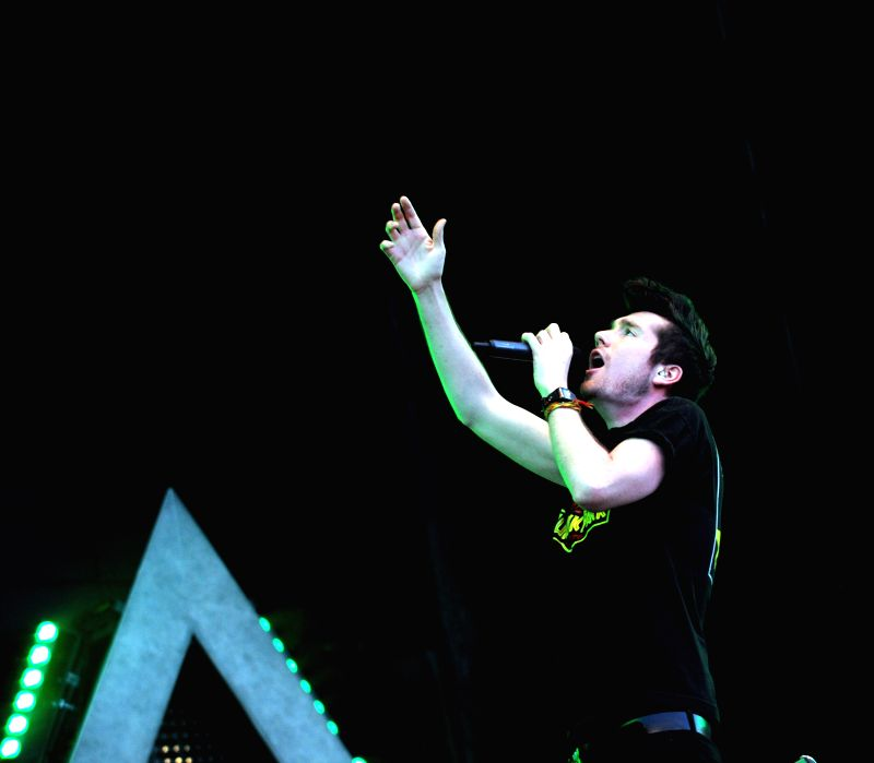 A member of the band BASTILLE performs at the Optimus Alive Music Festival in Lisbon, capital of Portugal on July 12, 2014. The three-day Optimus Alive Music ...