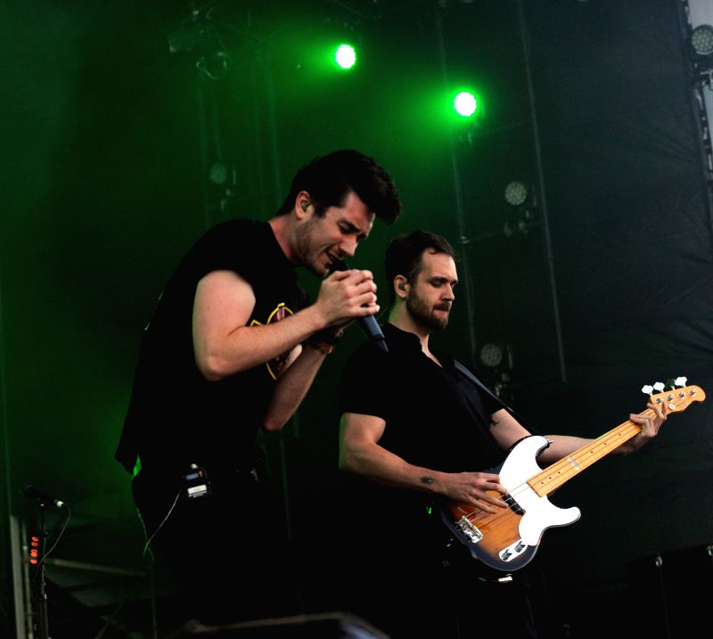 Members of the band BASTILLE perform at the Optimus Alive Music Festival in Lisbon, capital of Portugal on July 12, 2014. The three-day Optimus Alive Music Festival .