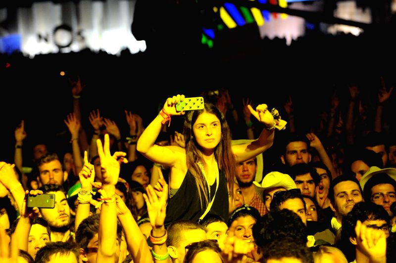 People attend the Optimus Alive Music Festival held in Lisbon, capital of Portugal on July 12, 2014. The three-day Optimus Alive Music Festival closed in Lison on ...