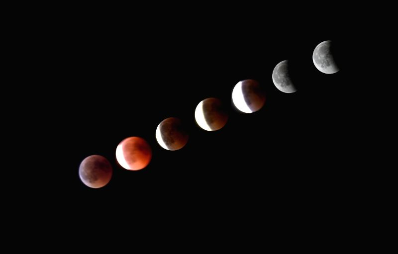 LISBON, July 28, 2018 - Combo photo taken on July 27, 2018 shows different stages of the moon during a lunar eclipse in Lisbon, Portugal.