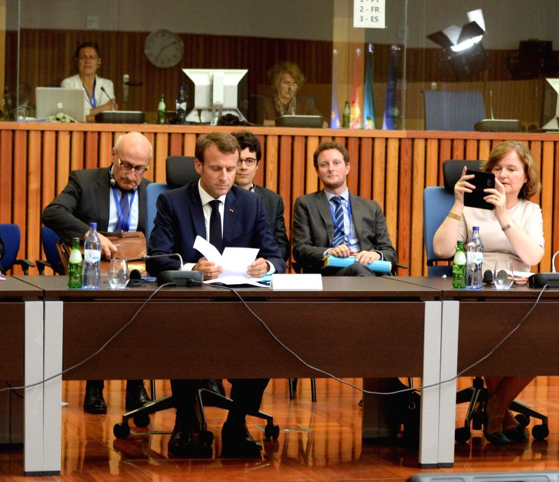LISBON, July 28, 2018 - French President Emmanuel Macron (Front) attends the Energy Interconnections Summit at the European Maritime Safety Agency in Lisbon, Portugal, on July 27, 2018. Portuguese, ...