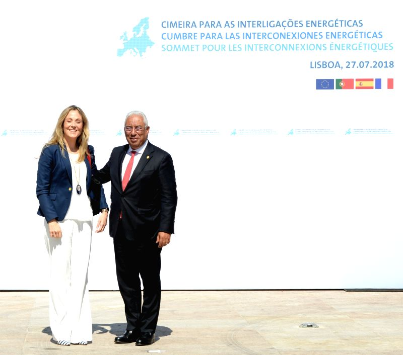 LISBON, July 28, 2018 - Portuguese Prime Minister Antonio Costa (R) greets European Investment Bank Vice President Emma Navarro upon her arrival for the Energy Interconnections Summit at the European ... - Antonio Costa