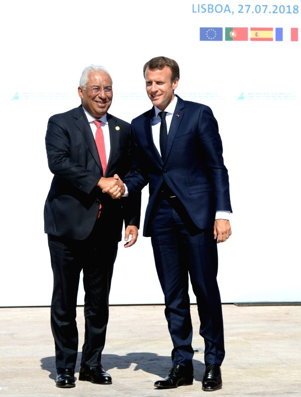 LISBON, July 28, 2018 - Portuguese Prime Minister Antonio Costa (L) greets French President Emmanuel Macron upon his arrival for the Energy Interconnections Summit at the European Maritime Safety ... - Antonio Costa