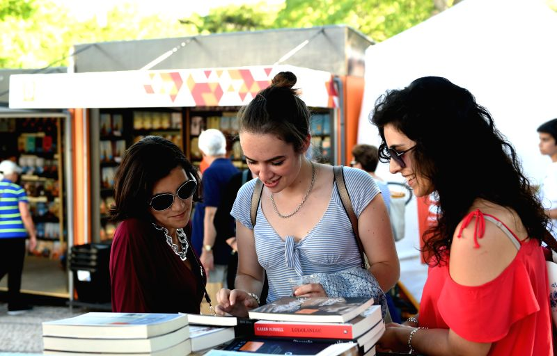 LISBON, June 11, 2017 - People visit the 87th Portugal's book fair in Lisbon, Portugal, June 7, 2017. The fair, which kicked off on June 1, will last until June 18 with an investment of 900,000 euros ...