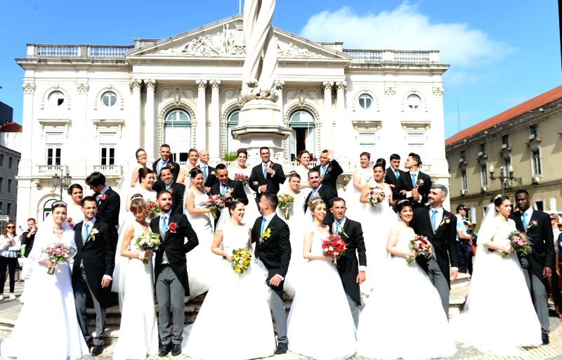 LISBON, June 12, 2018 - Couples take part in a group wedding in Lisbon, capital of Portugal, on June 12, 2018. A total of 16 couples got married during the group wedding as part of the month-long ...