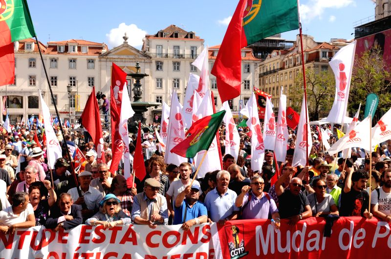 Protesters shout slogans while taking part in a protest in Lisbon, Portugal, June 21, 2014. Thousands of Portuguese took to the streets in the national capital of ...