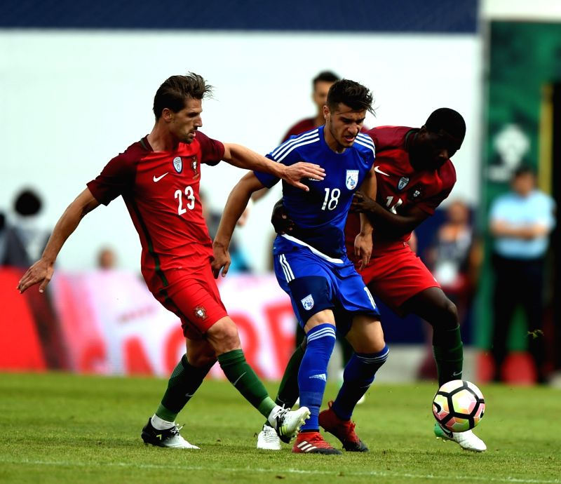 LISBON, June 4, 2017 - Portugal's William Carvalho (R) vies with Kostakis Artymatas (M) of Cyprus during the international friendly soccer match Portugal vs Cyprus at the Antonio Coimbra da Mota ...