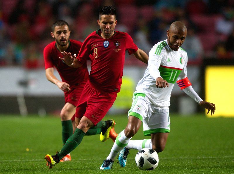 LISBON, June 8, 2018 - Joao Moutinho (C) of Portugal vies with Yacine Brahimi (R) of Algeria during the international friendly soccer match between Portugal and Algeria at Luz Stadium in Lisbon, ...