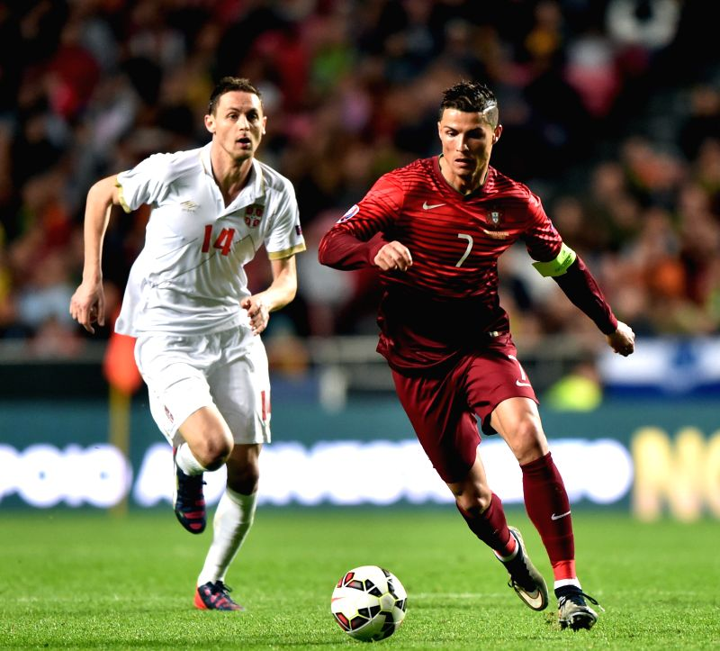 Cristiano Ronaldo (R) of Portugal vies with Nemanja Matic of Serbia during their UEFA Euro 2016 Group I qualifying match in Lisbon, Portugal, March 29, 2015. ...