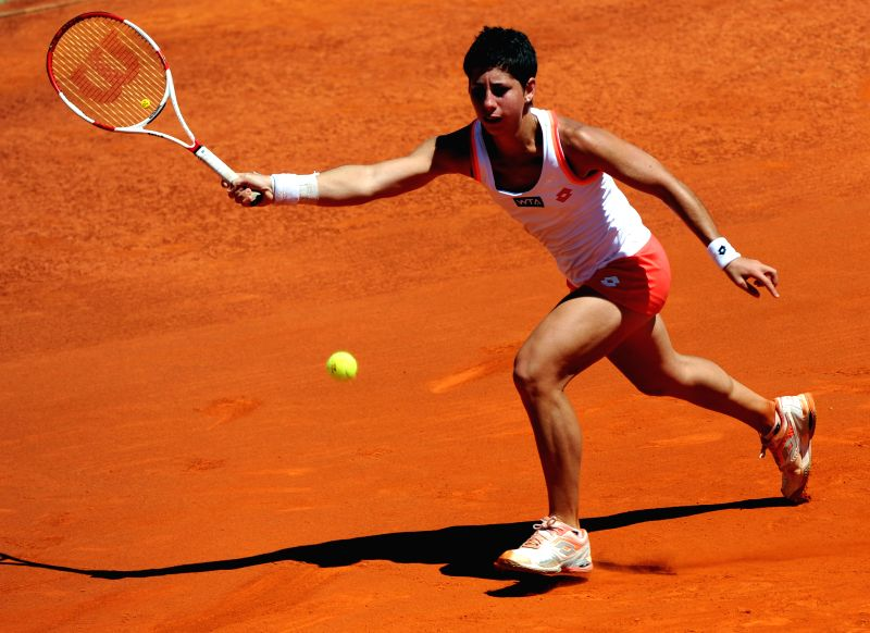 Carla Suarez Navarro of Spain returns the ball to Svetlana Kuznetsova of Russia during their women's singles final match at the 2014 Portugal Tennis Open in Lisbon, ..