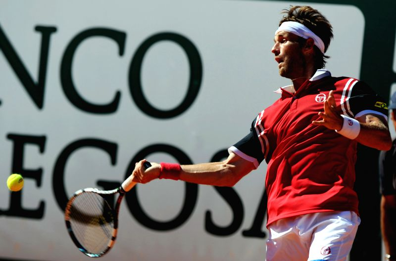 Daniel Gimeno-Traver of Spain returns the ball during the men's singles semifinal match against Carlos Berlocq of Argentina at the 2014 Portugal Tennis Open in ...