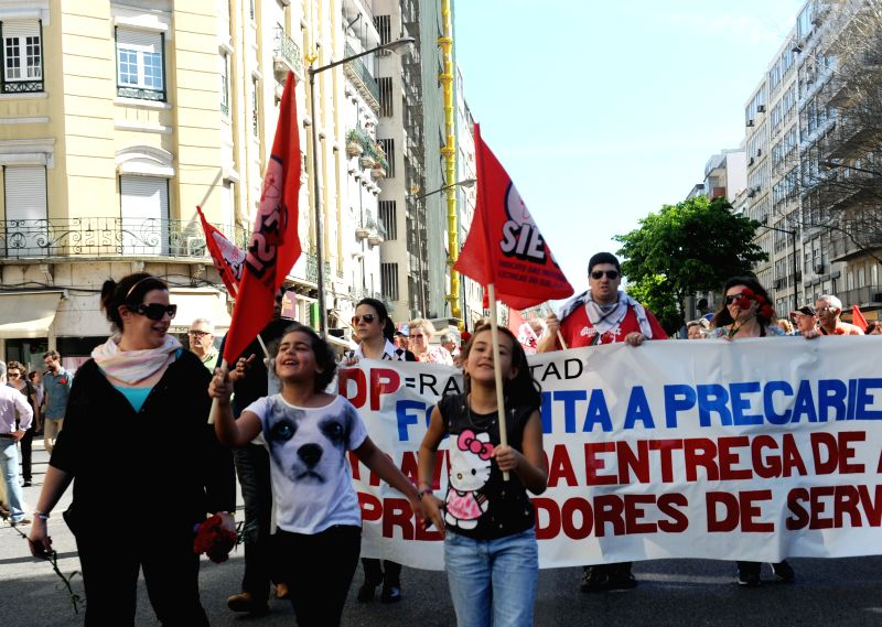 People participate in a Labor Day rally organized by the General Confederation of Portuguese Workers to protest against government's austerity measures in Lisbon, May .