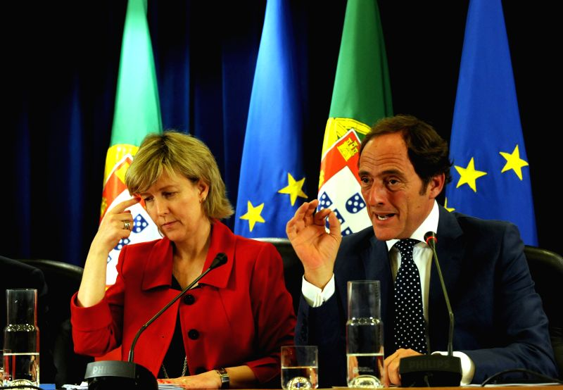 Portugal's Deputy Prime Minister Paulo Portas (R) and Finance Minister Maria Albuquerque attend a press conference in Lisbon, Portugal, on May 2, 2014. Portugal passed - Paulo Portas