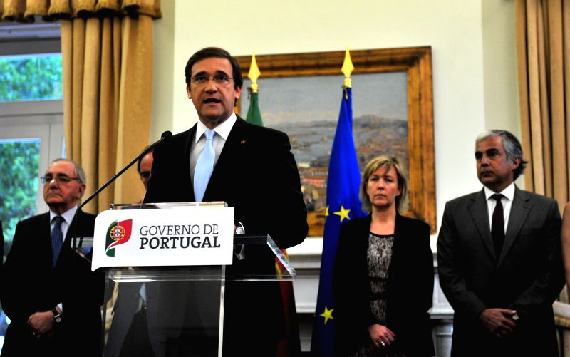 Portuguese Prime Minister Pedro Passos Coelho (front) speaks in a televised nationwide speech in Lisbon, capital of Portugal, May 4, 2014. Portuguese Prime Minister ...