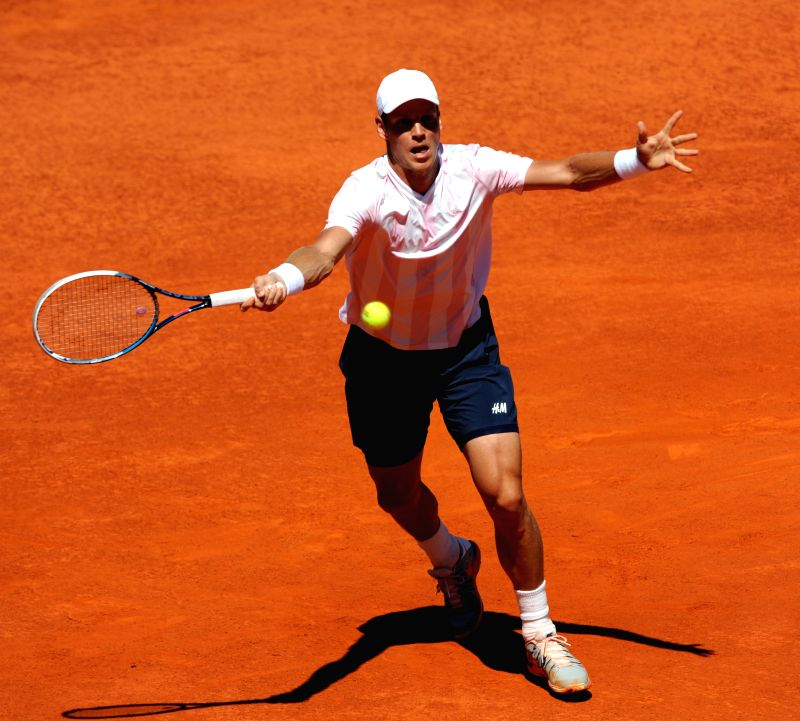 Tomas Berdych of Czech Republic returns the ball during the men's singles semifinal match against Victor Hanescu of Romania at the 2014 Portugal Tennis Open in Lisbon,