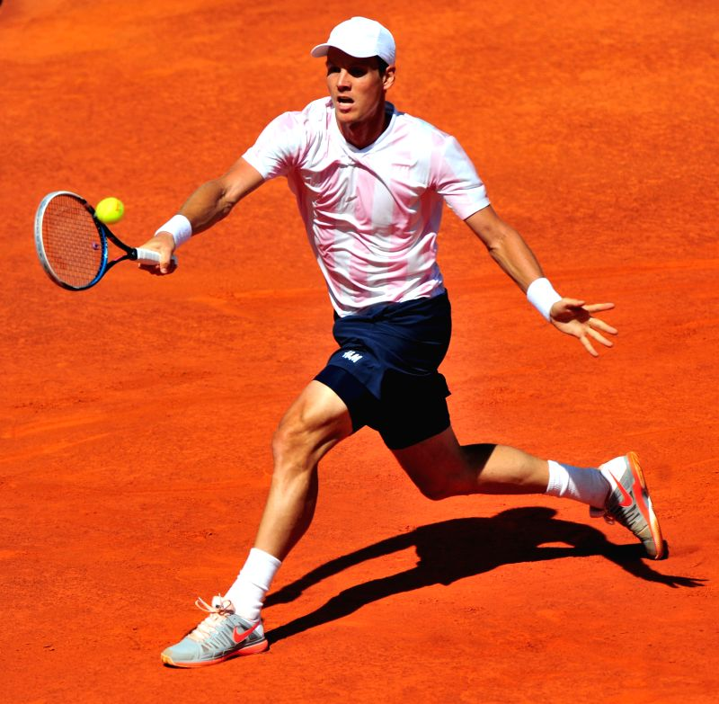 Tomas Berdych of the Czech Republic hits a return to Carlos Berlocq of Argentina during the Portugal Open final at Jamor stadium in Oeiras, outskirts of Lisbon, ...