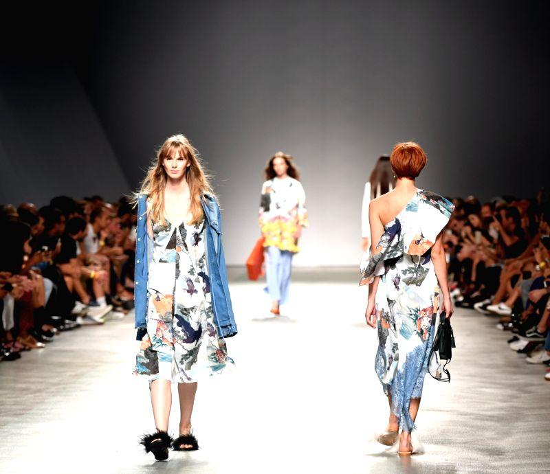 LISBON, Oct. 7, 2017 - Models present creations of Portuguese designer Ricardo Preto during the Lisbon Fashion Week Spring/Summer 2018 in Lisbon, Portugal, Oct. 6, 2017.