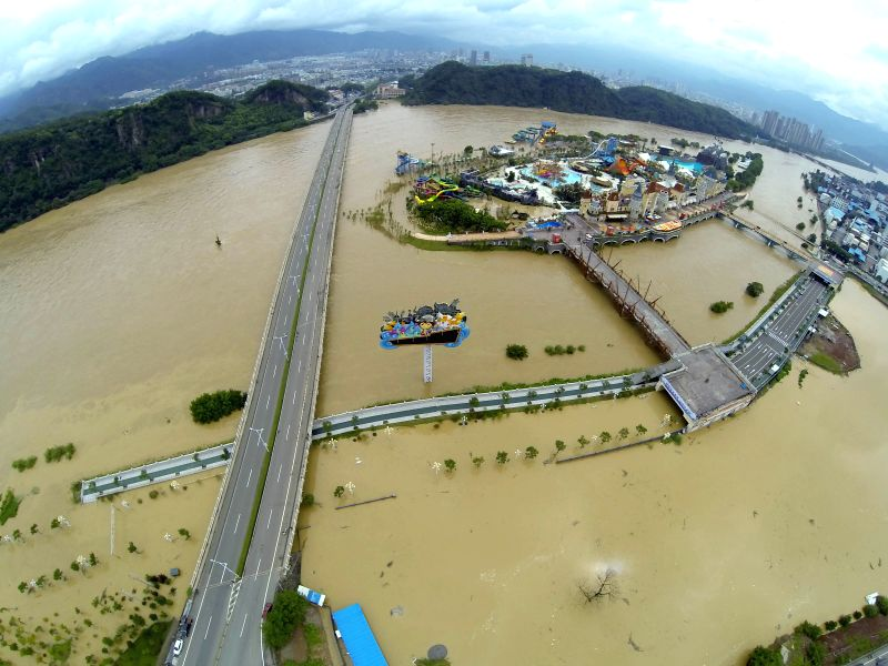 Aerial photo taken on Aug. 20, 2014 shows the rising water level in Oujiang River in Lishui City, east China's Zhejiang Province. Over 20,000 people have been ...