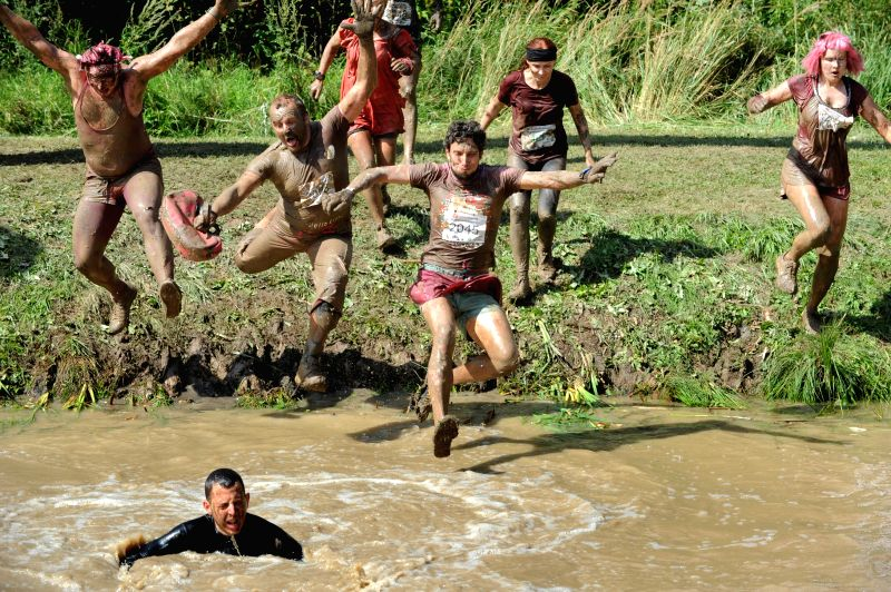 """Participants compete in the extreme running """"Beaver path 2014"""" in Sirvintu district,  Lithuania, on Aug.10, 2014. Lithuania held the extreme running ..."""
