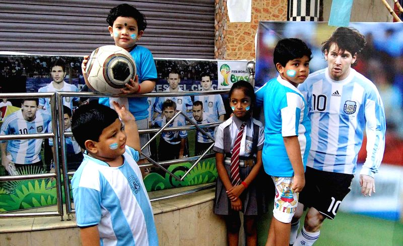 Little fans of Argentine football team dressed in team's colours ahead of FIFA World Cup Finals in Howrah on July 12, 2014.