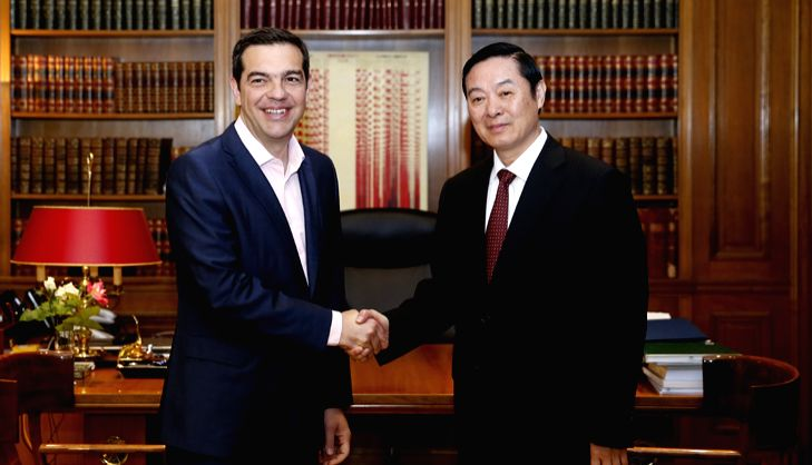 Liu Qibao (R), head of the Publicity Department of the Central Committee of the Communist Party of China (CPC), shakes hands with Greek Prime Minister Alexis Tsipras in Athens, Greece, April ... - Alexis Tsipras